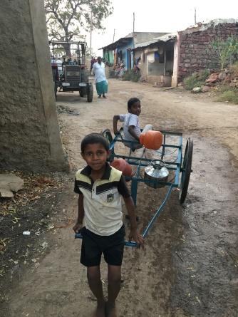 children carrying pots